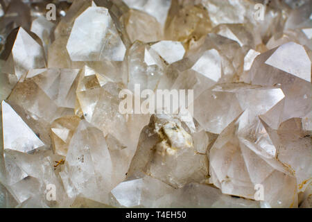 Huge crystal of colorless gemstone quarts, geology mineral background close up - Stock Image