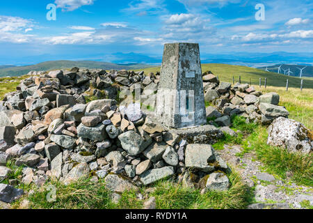The trig point at the summit of Ben Cleuch in the Ochil Hills, Clackmannanshire, Scotland, UK - Stock Image