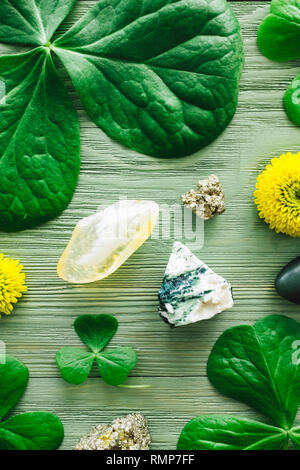 Citrine, Tree Agate, Jade and Pyrite with Shamrocks and Yellow Chrysanthemums - Stock Image
