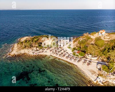 Beach and beach bar on Thasos Island, Greece, aerial view - Stock Image