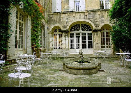 Arles; Bouches du Rhone, France; A courtyard to a high-end hotel - Stock Image