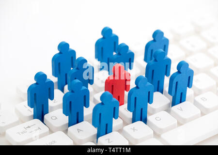 Unique person in the crowd on computer keyboard - Stock Image