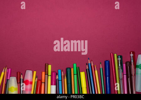Copy space on colorful background with stationery. Back to school concept. Pens, pencils,markers. - Stock Image