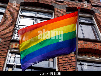Gay rainbow flag in Reguliersdwarsstraat, Amsterdam, Netherlands - Stock Image