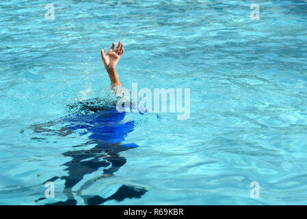 Male boy struggling underwater drowning in swimming pool. concept of safety - Stock Image