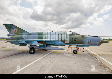 Three-color camouflaged MiG-21 BIS-d of HRZ Croatian Air Force on apron in Zemunik AFB base - Stock Image