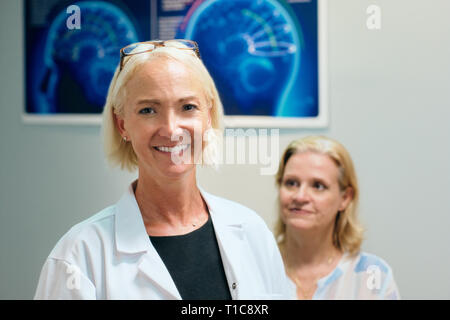 Portrait Of Happy Woman Smiling Working As Doctor In Hospital - Stock Image