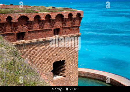 Dry Tortugas National Park - Florida - Brick inlaid corner section with moat in view and crystal peacock blue waters - Stock Image