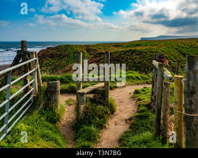 A stile on a path from the Cleveland Way towards the sea between Marske and Saltburn on the North Yorkshire Coast - Stock Image