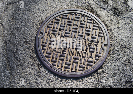 NYC sewer manhole cover made in India - Stock Image