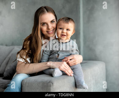 Little child smiling and happy with mom - Stock Image