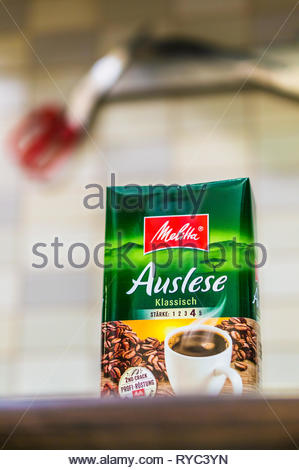 Poznan, Poland - March 9, 2019: German Melitta Auslese coffee in a package on a wooden table. - Stock Image