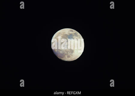 Color Moon on night sky. Natural colors of our satellite emphasized in postproduction - Stock Image