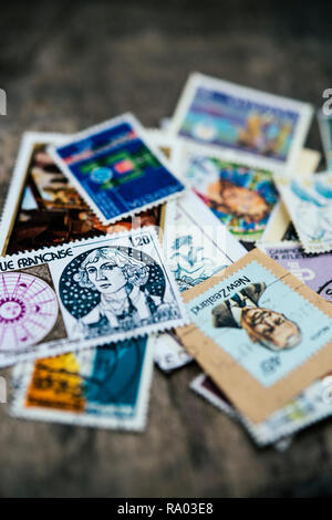 Selection of used postage stamps from around the world - Stock Image