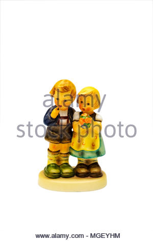 Hummel figurine of boy and girl with bouquet of flowers - Stock Image