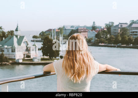 Woman sightseeing Helsinki city landmarks summer vacations in Finland traveling by ferry lifestyle blonde girl tourist relaxing alone - Stock Image