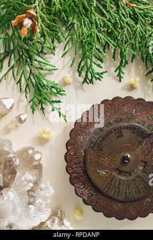 Antique Calendar with Smoky Quartz and Incense Cedar - Stock Image