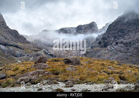 The glaciated corrie of Coire Lagan, high in the Black Cuillin Mountains with summit of Sgurr Mhic Choinnich, Glenbrittle, Isle of Skye, Scotland, UK - Stock Image