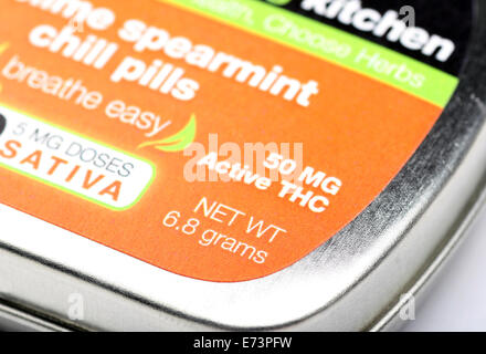 Close-up on the words 50 MG Active THC on a tin of 'Sublime Spearmint Chill Pills,' a form of legal edible - Stock Image