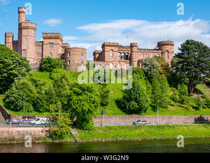 View across River Ness to Inverness Castle on hilltop on sunny day, Inverness, Scotland, UK - Stock Image