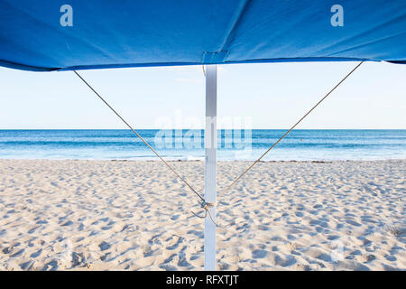 Awning structure for beach chair. Beach background - Stock Image