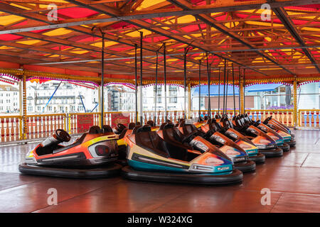 Bumper cars or dodgems lined up in an amusement park or fairground - Stock Image