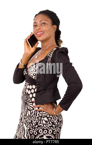Pretty business woman talking on cell phone standing on white background - Stock Image