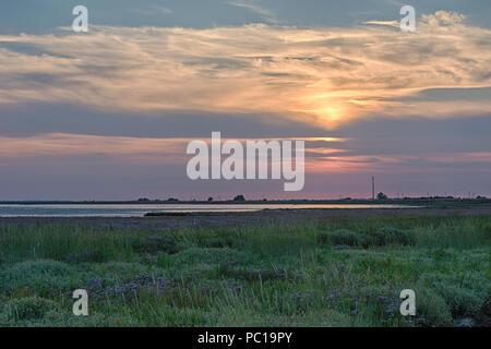 Sunset over Breydon Water, Great Yarmouth, Norfolk. - Stock Image