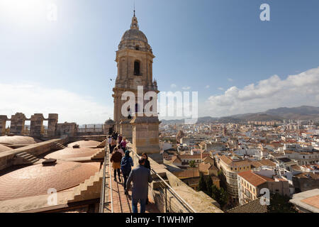 Tourists on a guided tour of the roof, with the belltower, Malaga Cathedral roof, Malaga, Andalusia, Spain Europe - Stock Image