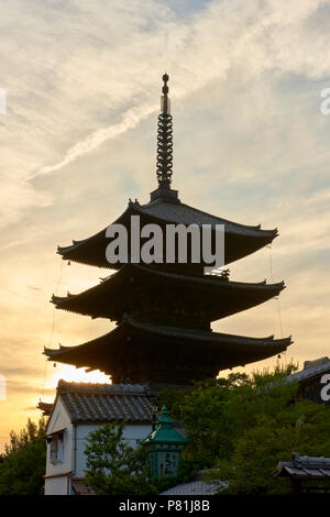 Silhouete of Hokanji Temple Pagoda with beautiful sunset yellow sky in the background, in Kyoto, Japan. - Stock Image
