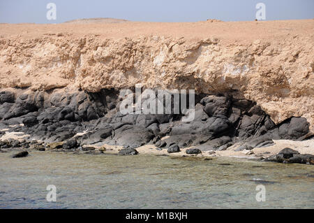 Big Brother Island in the Red Sea, the volcanic rocks of the island base - Stock Image