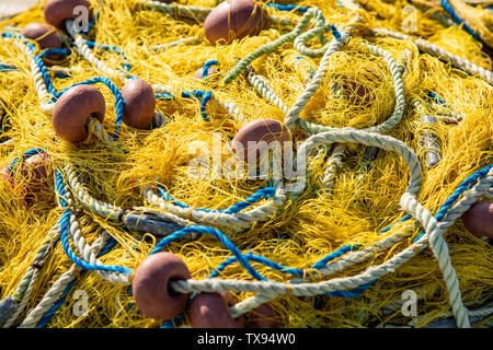 heap of fishing nets  with rope and floatings - Stock Image