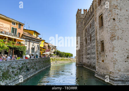 SIRMIONE, LAKE GARDA, ITALY - SEPTEMBER 2018: The walls and moat of Scaliger Castle in the centre of  Sirmione on Lake Garda. - Stock Image