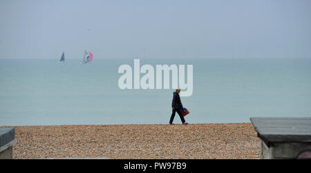 Brighton UK 14th October 2018 - Brighton beach is very quiet on a gloomy day along the south coast with rain forecast for most parts of Britain today Credit: Simon Dack/Alamy Live News - Stock Image
