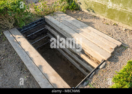 Newly dug grave at cemetery at Sejerø Church in Sejerby - Stock Image