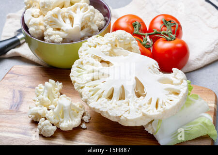 Healthy vegetarian food concept, raw cauliflower white cabbage ready for cooking - Stock Image
