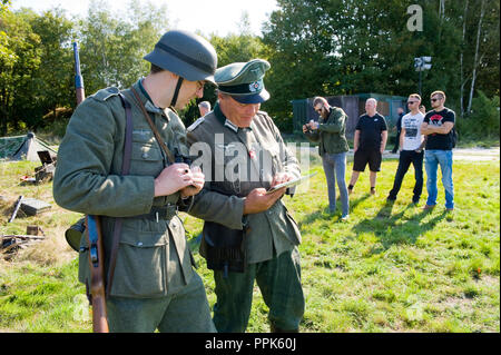 ENSCHEDE, THE NETHERLANDS - 01 SEPT, 2018: German soldiers studying a map during a military army show. - Stock Image