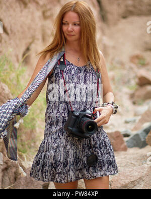 Lady with camera in Canyon. South Sinai. Egypt - Stock Image
