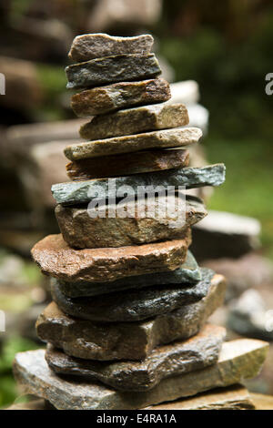 Nepal, Pokhara, Nangathanti, small cairn or shrine made from pile of rocks beside path to Ghorapani - Stock Image