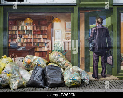 Downtown city Waren, painted wall, recyling bags, lake Mueritz, Mecklenburg-Vorpommern, Germany - Stock Image
