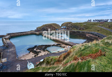 Portknockie harbour, an old herring fishing village located in Morayshire, north coast of Scotland, UK. - Stock Image
