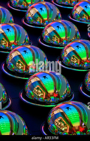 reflection of a man on colorful glass spheres - Stock Image