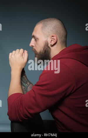 Thoughtful man with beard - Stock Image