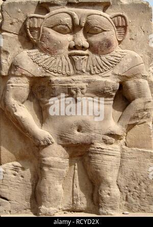 6223. God Bes, protector of households according to Egyptian Mythology, Dandara, Egypt - Stock Image