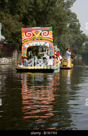 Trajinera Boat on the Canals of the Floating Gardens of Xochimilco Mexico City - Stock Image