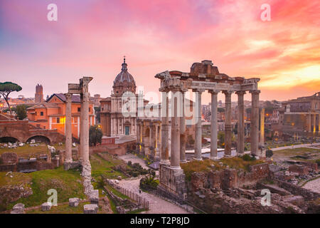 Ancient ruins of a Roman Forum or Foro Romano at sunsrise in Rome, Italy. View from Capitoline Hill - Stock Image