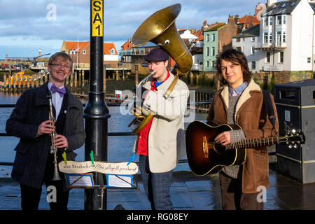 Three street musicians in Whitby playing as the Jelly Roll Jazz Band - Stock Image