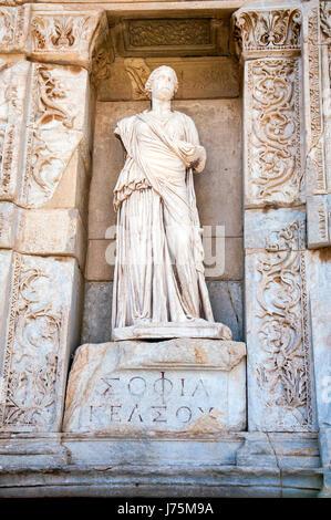 Statue of Sophia (Wisdom) in front of Library of Celsus, Ephesus, Turkey - Stock Image