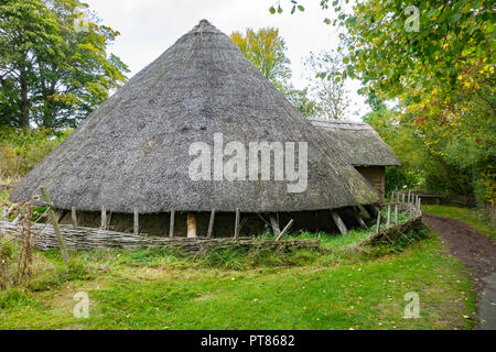 A reconstruction of an Iron Age Roundhouse used from the 7th century BC until 43 AD,  Ryedale Folk Museum in Hutton le Hole North Yorkshire England UK - Stock Image