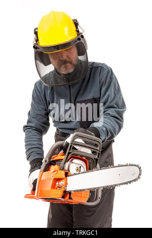 Man in safety gear holding chainsaw - Stock Image